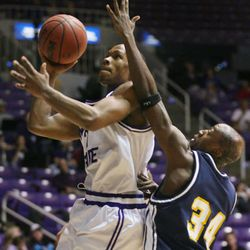 Weber State guard Nick Covington scores two of his 28 points while being defended by Northern Arizona's Marques Green (cq) during the Wildcats' home game against the Lumberjacks January 12, 2006 in Ogden, Utah. NAU beat Weber 88-82.  Photo by Keith Johnson/Deseret Morning News