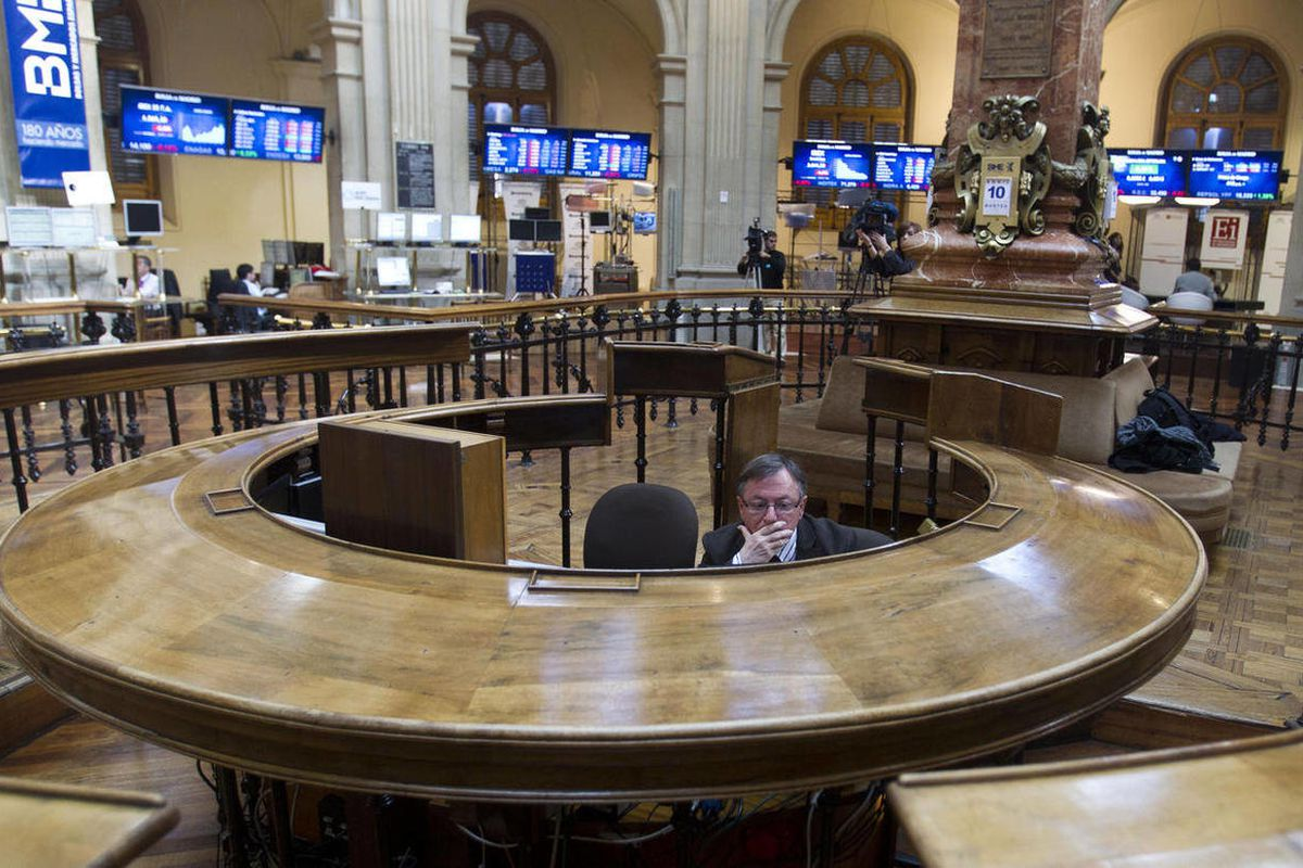 A broker sits in the stock exchange in Madrid Tuesday April 10, 2012.  Worries about Spain's finances intensified Tuesday, when the country's bond yields on international markets rose despite expectations of a new round of austerity measures. The Spanish