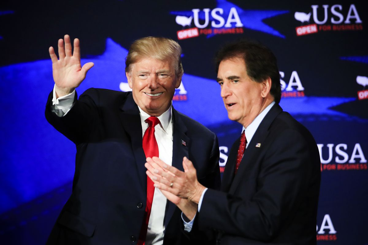 President Trump with Rep. Jim Renacci (R-Ohio) waves during a roundtable discussion on tax cuts held in Cleveland, Ohio on May 5, 2018.