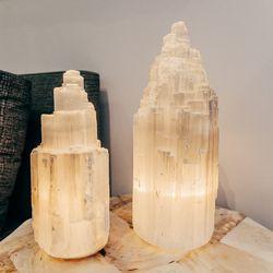 """Medium Selenite Iceberg Lamp, <a href=""""http://jungleeny.com/medium-selenite-iceberg-lamp.html"""">$225</a>, Large Selenite Iceberg Lamp, <a href=""""http://jungleeny.com/large-selenite-iceberg-lamp.html"""">$275</a>"""