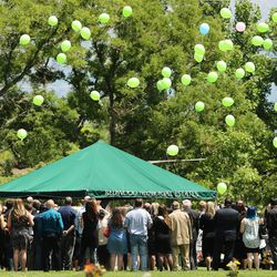 Balloons are released during the funeral for Memorez Rackley and her son, Jase, at Memorial Redwood Mortuary and Cemetery in West Jordan on Tuesday, June 20, 2017.