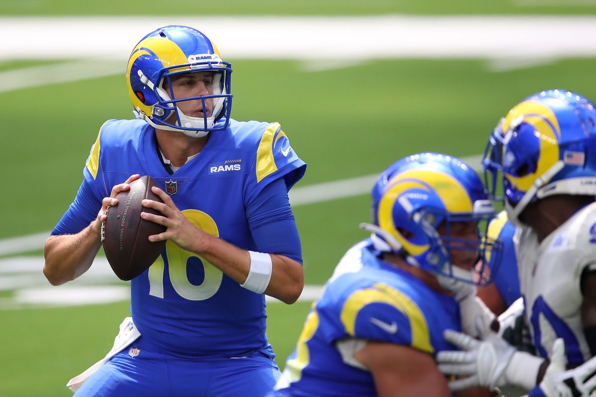 Jared Goff of the Los Angeles Rams rolls out on a play during a team scrimmage at SoFi Stadium on August 29, 2020 in Inglewood, California.