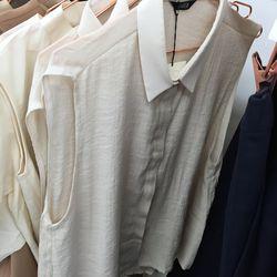 Kaarem sleeveless button down cream top, $50 (was $140)