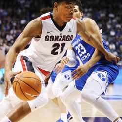 Gonzaga Bulldogs forward Rui Hachimura (21) drives around Brigham Young Cougars forward Yoeli Childs (23) as BYU and Gonzaga play in an NCAA basketball game in the Marriott Center in Provo on Saturday, Feb. 24, 2018. Gonzaga won 79-65.