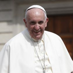 Pope Francis smiles as he arrives at the  Santa Maria Ausiliatrice Basilica, in Turin, Italy, Sunday, June 21, 2015. Pope Francis earlier prayed in front of the Holy Shroud, the 14 foot-long linen revered by some as the burial cloth of Jesus, on display at the Cathedral of Turin.