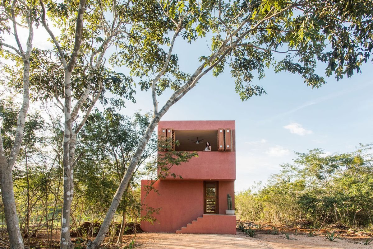 Red stucco house in remote landscape