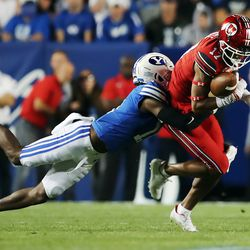 Brigham Young Cougars defensive back Isaiah Herron (11) makes a tackle on Utah Utes wide receiver Devaughn Vele (17) during an NCAA football game at LaVell Edwards Stadium in Provo on Saturday, Sept. 11, 2021.