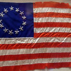 A flag made by Sarah Wilson, great-granddaughter of Betsy Ross, is on display at the Independence Through History Museum in the Grand America in Salt Lake City on Friday, July 5, 2013.