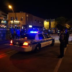 A Chicago Police car making its way west on Waveland, before game time