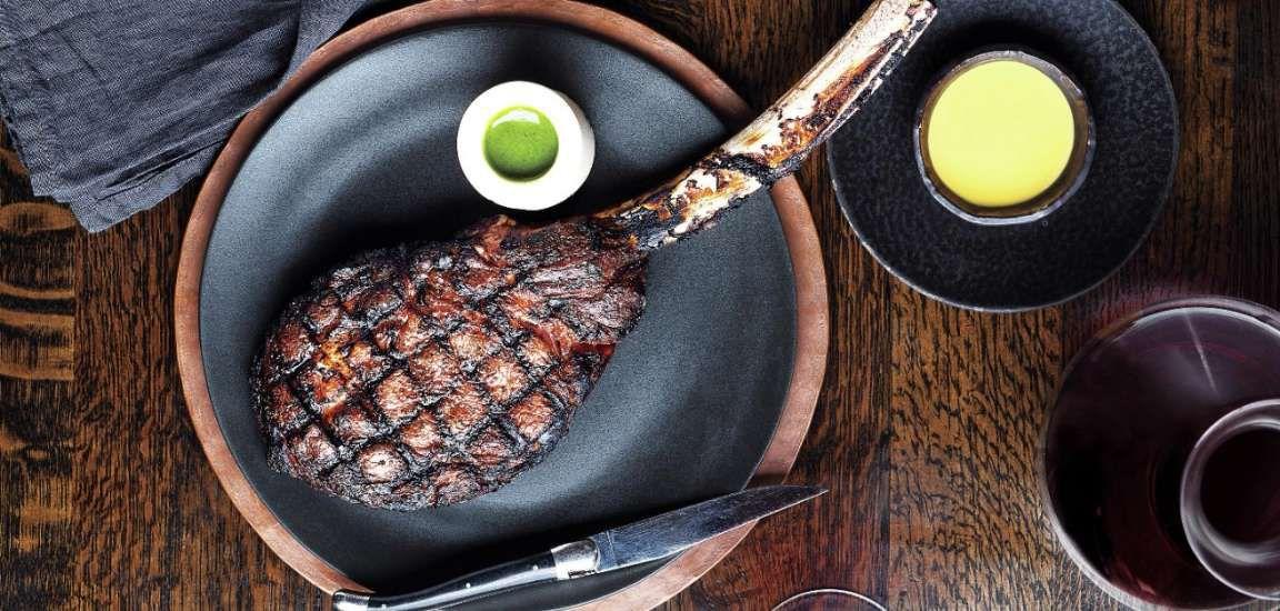 A steak on a gray plate