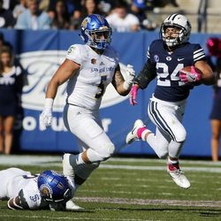 Brigham Young Cougars running back KJ Hall runs the ball with San Jose State Spartans linebacker Frank Ginda at back left during NCAA football in Provo on Saturday, Oct. 28, 2017.