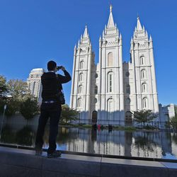 Snapping a photograph of the Salt Lake Temple during the opening session of the 183rd Semiannual General Conference of the Church of Jesus Christ of Latter-day Saints Saturday, Oct. 5, 2013, in Salt Lake City.
