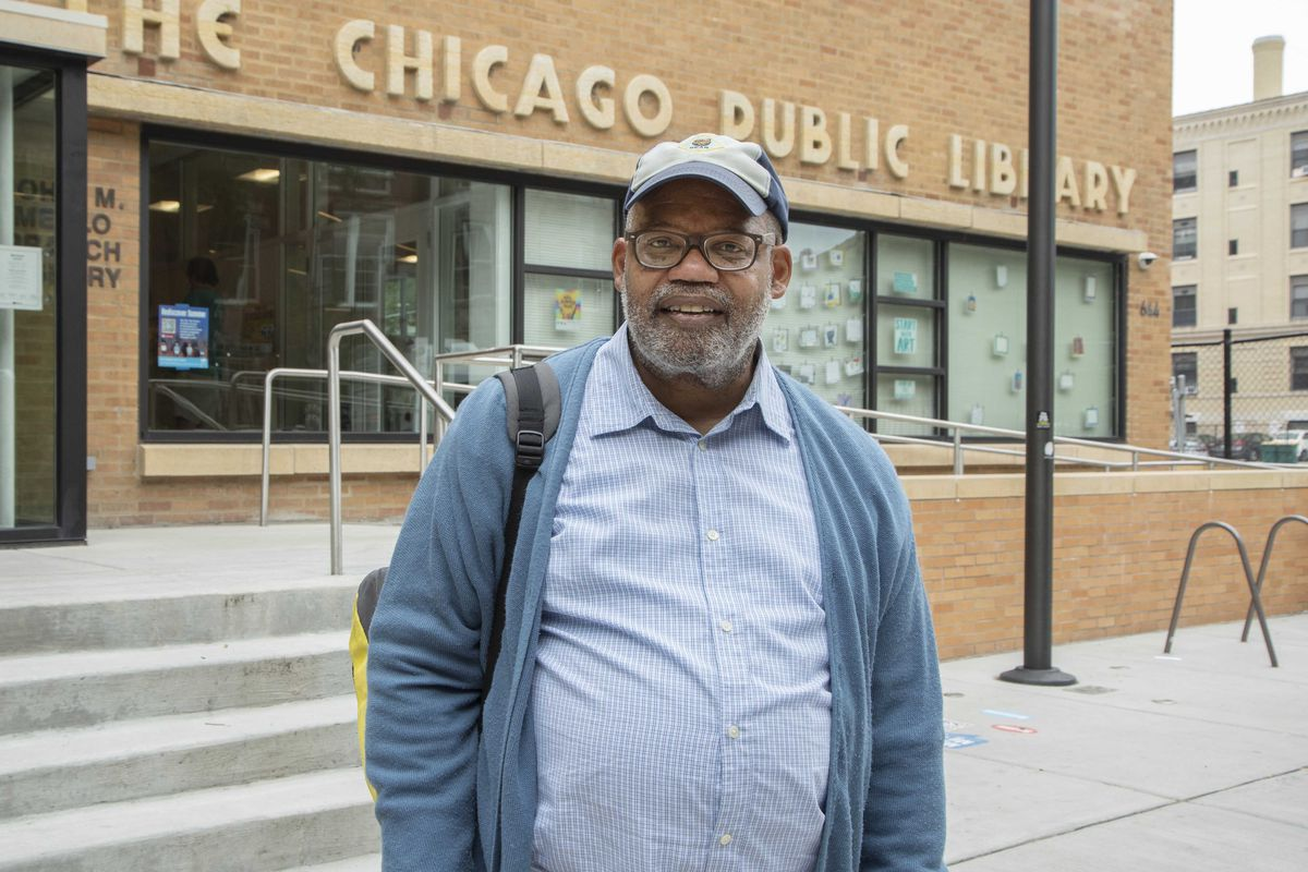 Darryl Grant stands in front of Merlo Library.
