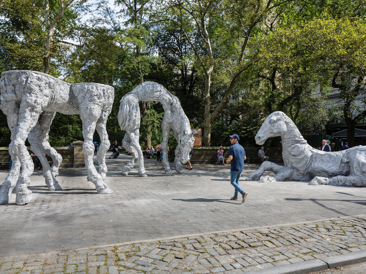 Three cast aluminum horse statues in one of the entrances of Central Park.