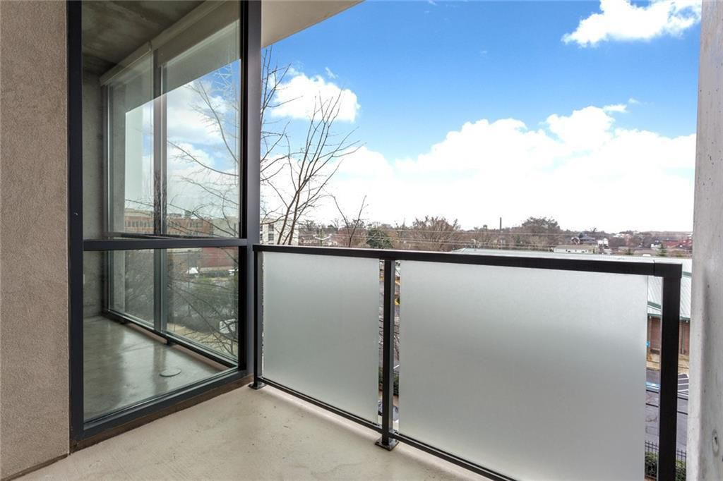 Small balcony with frosted wall railing.