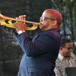 CORRECTS SPELLING OF FIRST NAME TO TERENCE - Terence Blanchard, foreground, and Herbie Hancock perform at a sunrise concert marking International Jazz Day in New Orleans, Monday, April 30, 2012. The performance, at Congo Square near the French Quarter, is one of two in the United States that day; the other is in the evening in New York. Thousands of people across the globe are expected to participate in International Jazz Day, including events in Belgium, France, Brazil, Algeria and Russia.