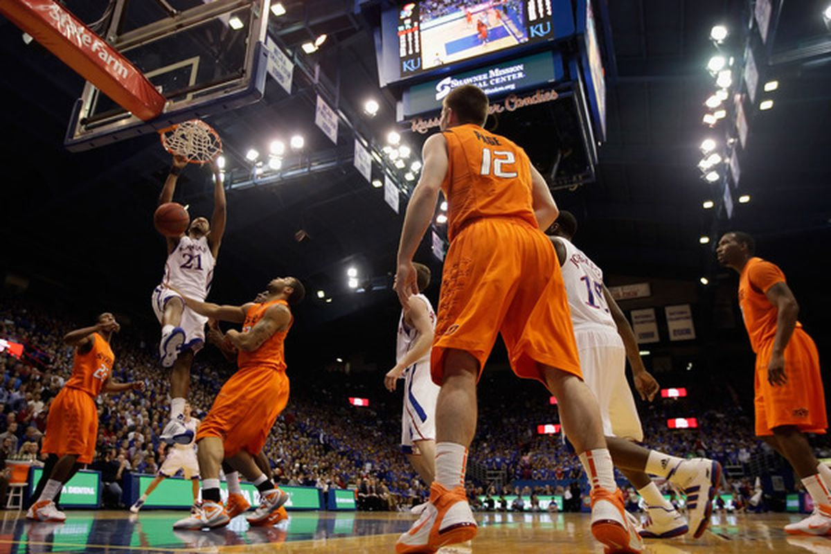 LAWRENCE KS - FEBRUARY 21:  Markieff Morris #21 of the Kansas Jayhawks dunks during the game against the Oklahoma State Cowboys on February 21 2011 at Allen Fieldhouse in Lawrence Kansas.  (Photo by Jamie Squire/Getty Images)