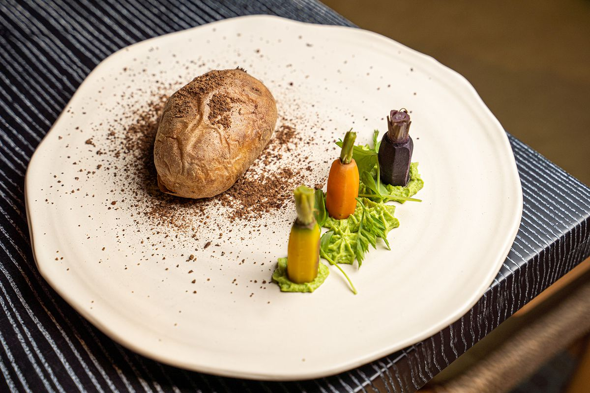 A potato stuffed with braised lamb with carrots.