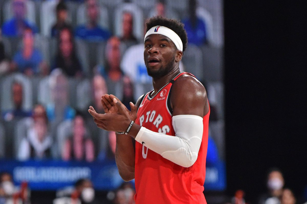Terence Davis of the Toronto Raptors claps during the game against the Orlando Magic on August 5, 2020 in Orlando, Florida at Visa Athletic Center at ESPN Wide World of Sports.
