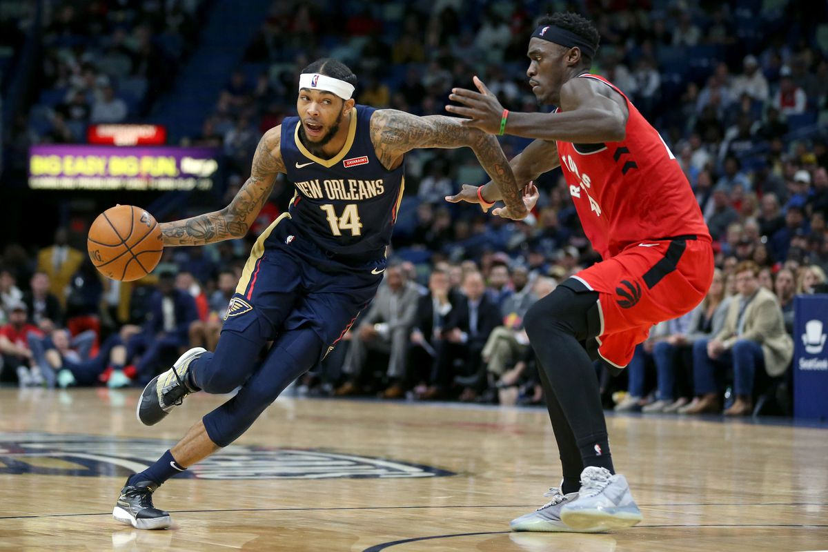 New Orleans Pelicans forward Brandon Ingram drives around Toronto Raptors forward Pascal Siakam in the second half at the Smoothie King Center.