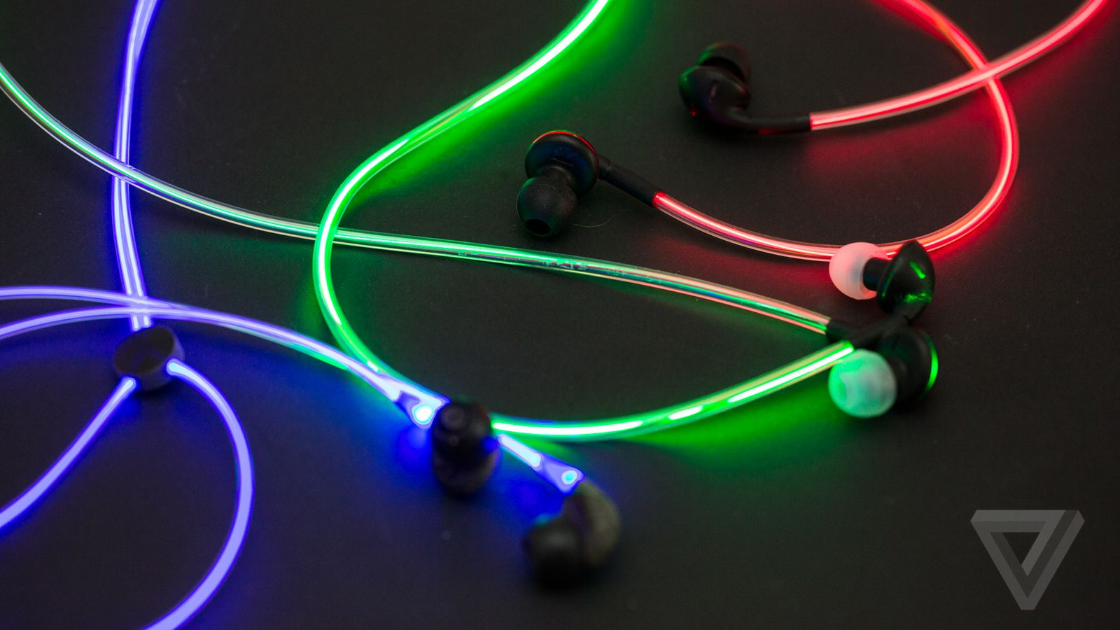 Up close with Glow\'s crazy laser light earbuds | The Verge