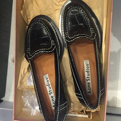 Acne Studios loafers, $205