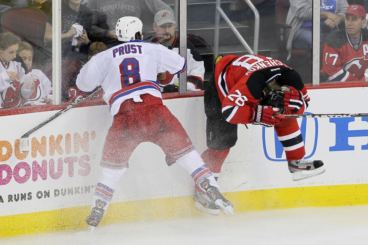 The follow-through of New York Ranger forward and honest player Brandon Prust's elbow on New Jersey Devil defenseman Anton Volchenkov.  (Photo by Jim McIsaac/Getty Images)