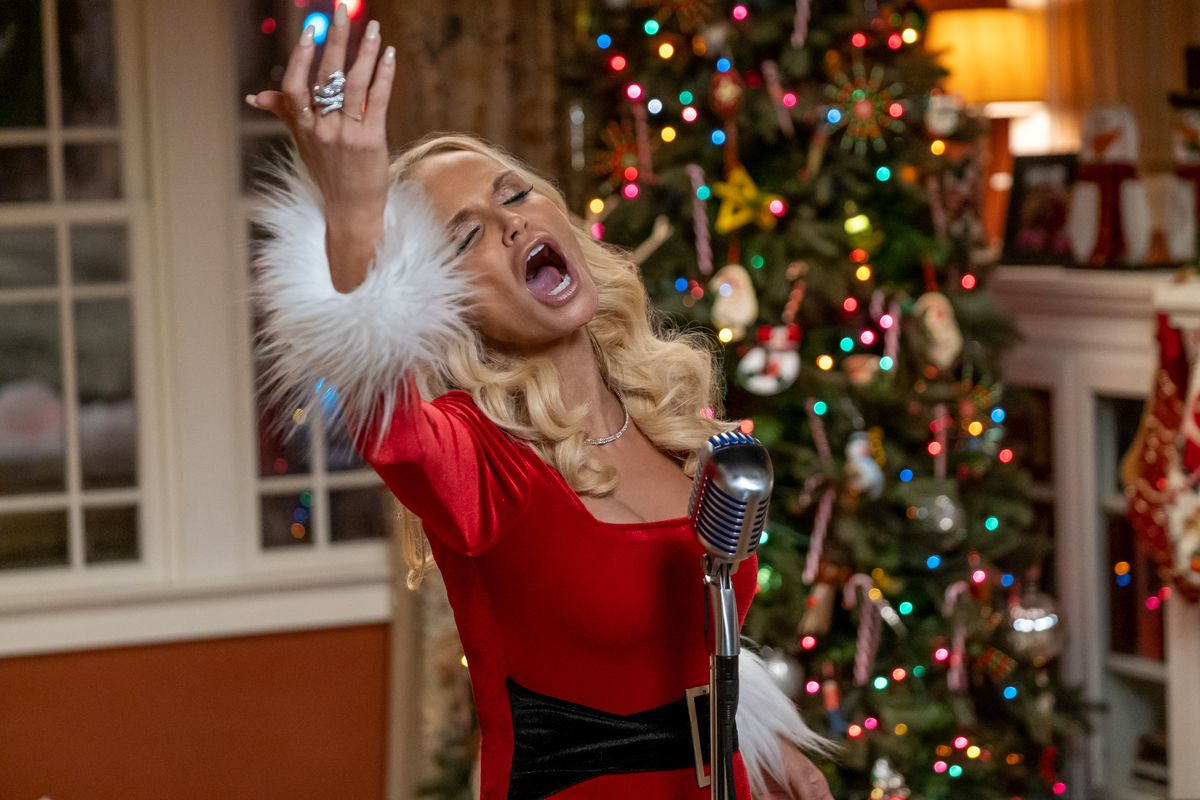 a woman in a santa costume sings