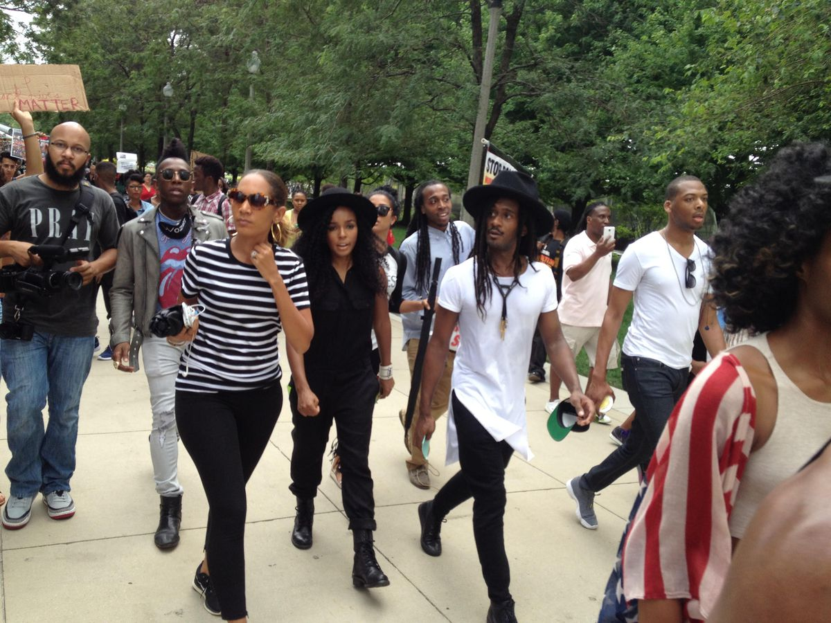 After speaking, Janelle Monae (center, dressed in black) leaves Millennium Park with musicians on her Wondaland Records label as protesters march to City Hall for a die-in. | Maudlyne Ihejirika/Sun-Times