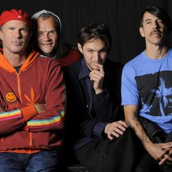 In this March 16, 2012 photo, members of the Red Hot Chili Peppers, from left, drummer Chad Smith, bassist Flea, guitarist Josh Klinghoffer and singer Anthony Kiedis pose for a portrait in the Hollywood section of Los Angeles. The group will be inducted into the Rock and Rock Hall of Fame on Saturday, April 14.