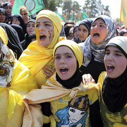 Lebanese girls chant slogans during a protest about a film ridiculing Islam's Prophet Muhammad in Lebanon's eastern city of Baalbek, Lebanon, Friday, Sept. 21, 2012. Tens of thousands of people take part for the latest in a series of protest rallies organized by the Shiite militant group Hezbollah. Anger over insults to Islam's Prophet Muhammad isn't enough to bring Lebanon's divided Sunni and Shiite Muslims together. The two sects, which have been locked in sometimes violent political competition, hold separate protests and even throw gibes. A hardline Sunni cleric accuses Shiite Hezbollah of using the protests to distract from the fighting in neighboring Syria.