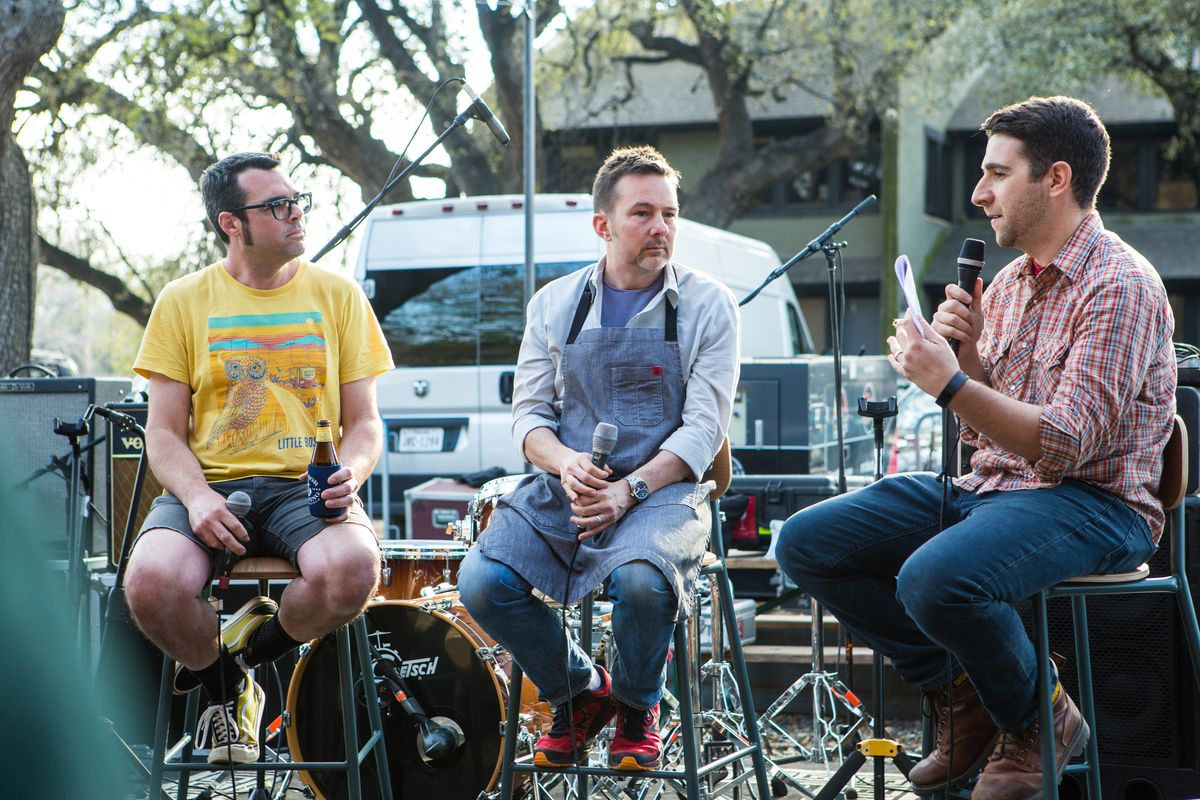 Aaron Franklin and Tyson Cole participating in a podcast at their new restaurant Loro