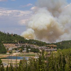 The Brian Head fire continues to burn along state Route 143 on Tuesday, June 20, 2017.