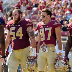 The Rest of the team captains, left to right, OL Alec Eberle, RS SR Jared Jackson, and DT Derrick Nnadi
