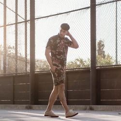 """Reinaldo of <a href=""""http://reyalfashion.com""""target=""""_blank"""">ReyalFashion</a> is wearing a Jonny IV shirt and shorts and <a href=""""http://shop.nordstrom.com/s/tsubo-aeson-wingtip-sneaker/3748518?cm_cat=datafeed&cm_ite=tsubo_'aeson'_wingtip_sneaker:997640_2"""