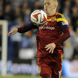 Real Salt Lake's Luke Mulholland controls a loose ball during a game at Sporting Park in Kansas City, Kan., on Saturday, April 5, 2014.