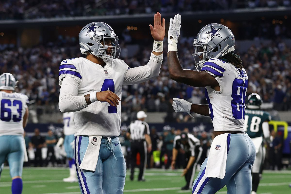 CeeDee Lamb #88 of the Dallas Cowboys celebrates his second half touchdown with Dak Prescott #4 while playing the Philadelphia Eagles at AT&T Stadium on September 27, 2021 in Arlington, Texas.