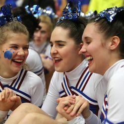 From left, Kendee Sanders, Kennedy Hansen, and Emily Woodyatt sit with their fellow Fremont High School cheerleaders after they competed in the state championships at Juan Diego Catholic High School in Draper on Saturday, Feb. 15, 2014. Kennedy recently died of juvenile Batten disease.