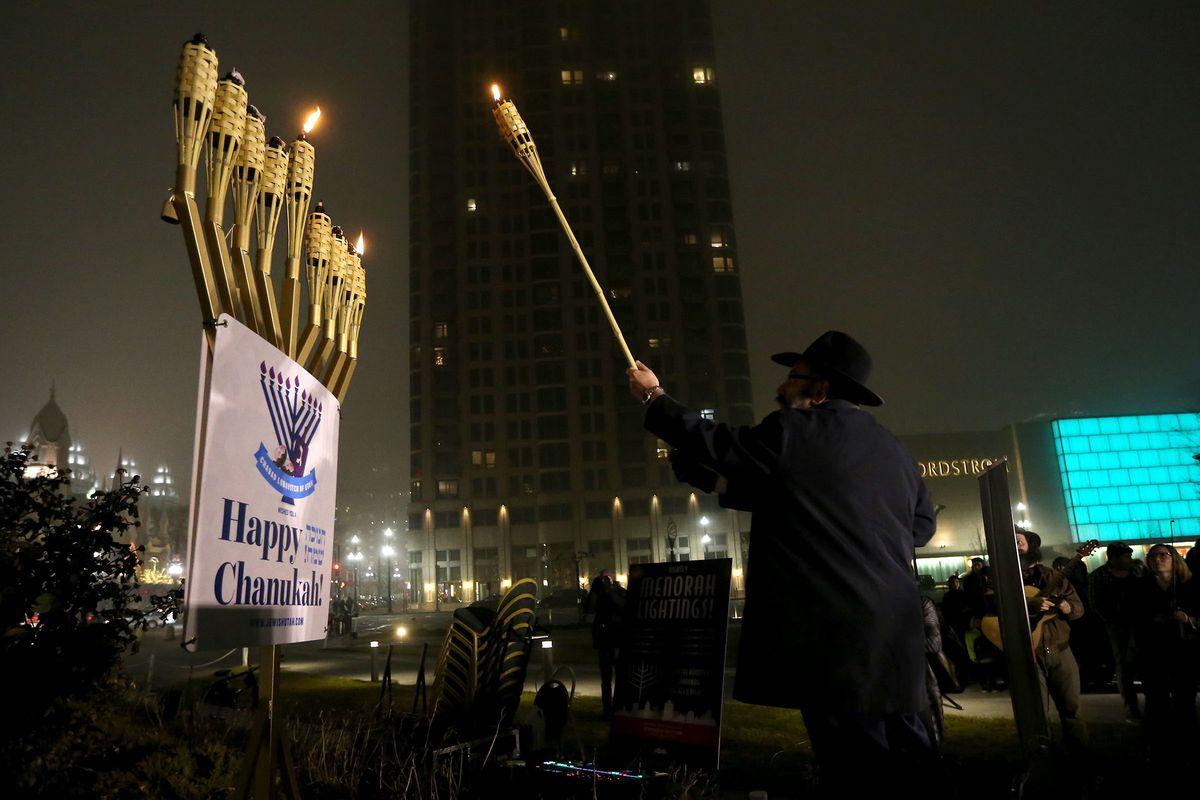 Rabbi Benny Zippel lights the menorah at Abravanel Hall Plaza in Salt Lake City on Tuesday, Dec. 12, 2017, to mark the start of Hanukkah.