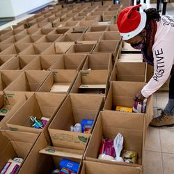 Yvonne Ryans checks boxes of food that will be distributed at Calvary Baptist Church in Salt Lake City on Saturday, Dec. 19, 2020.