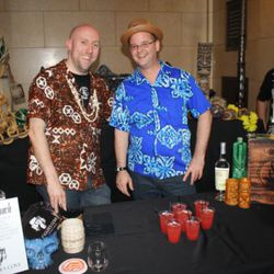 Martin Cate (left) served his usual Caribbean vacation in a glass at the Smuggler's Cove booth.