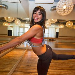 """<a href=""""http://la.racked.com/archives/2013/08/06/hottest_trainer_contestant_4_philly_elisa.php""""target=""""_blank"""">Philly Elisa of Pop Physique</a>"""