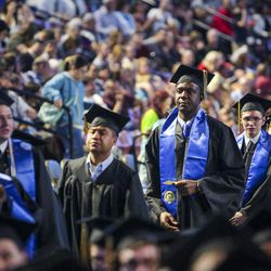 Salt Lake Community College graduates wait to walk across the stage and receive their diplomas during the 2017 commencement ceremony at the Maverik Center in West Valley City on Friday, May 5, 2017.