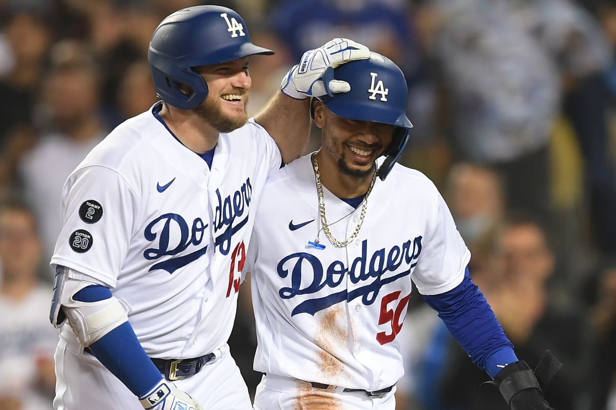 Los Angeles Dodgers first baseman Max Muncy returns to the dugout after hitting a two run home run to score right fielder Mookie Betts against the Arizona Diamondbacks in the third inning at Dodger Stadium.