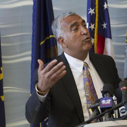 Salt Lake District Attorney Sim Gill speaks during a press conference at the FBI's Salt Lake City Division office about the arrests of former Utah Attorneys General Mark Shurtleff and John Swallow, Tuesday, July 15, 2014.