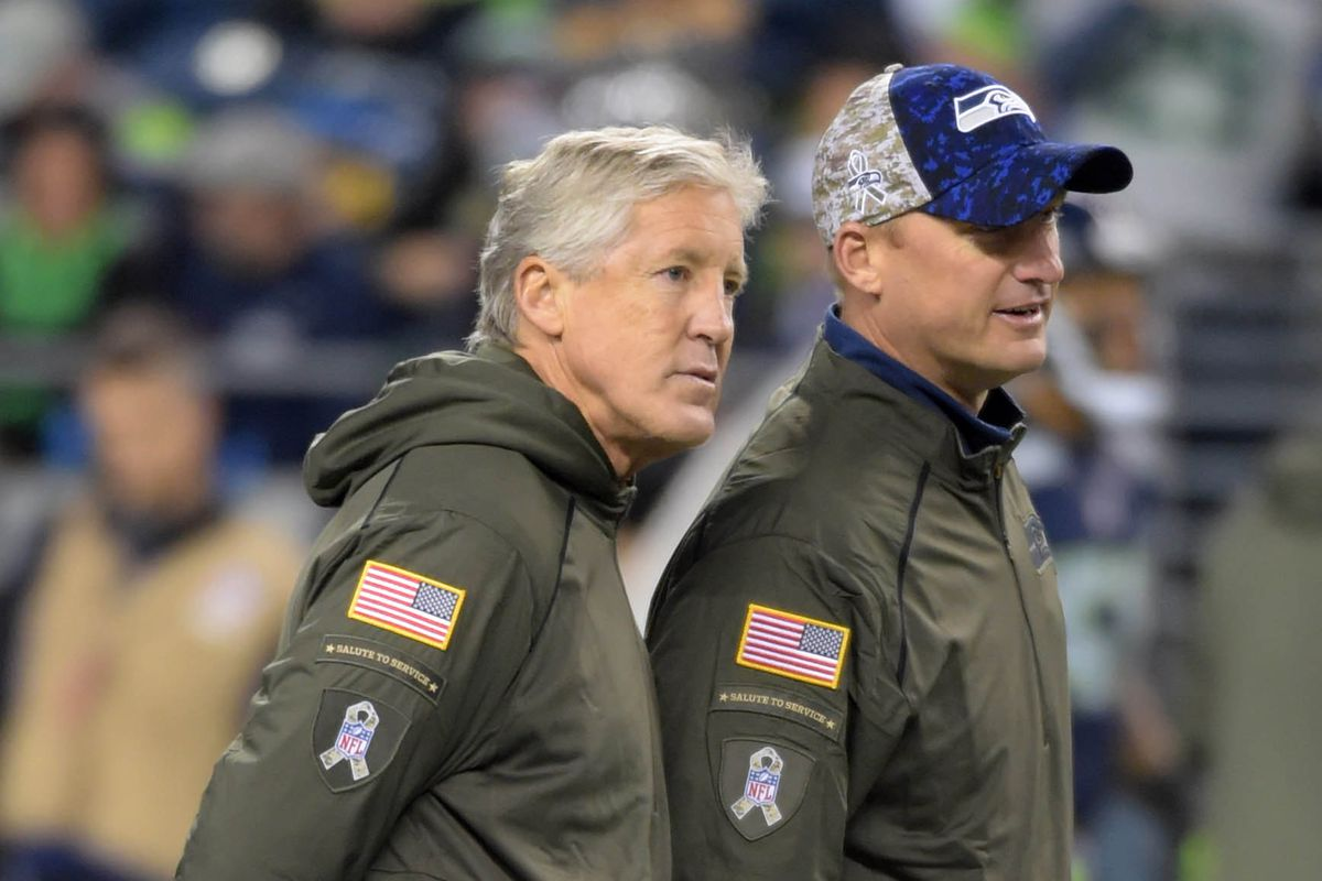 Seattle Seahawks head coach Pete Carroll (left) and offensive coordinator Darrell Bevell (right)