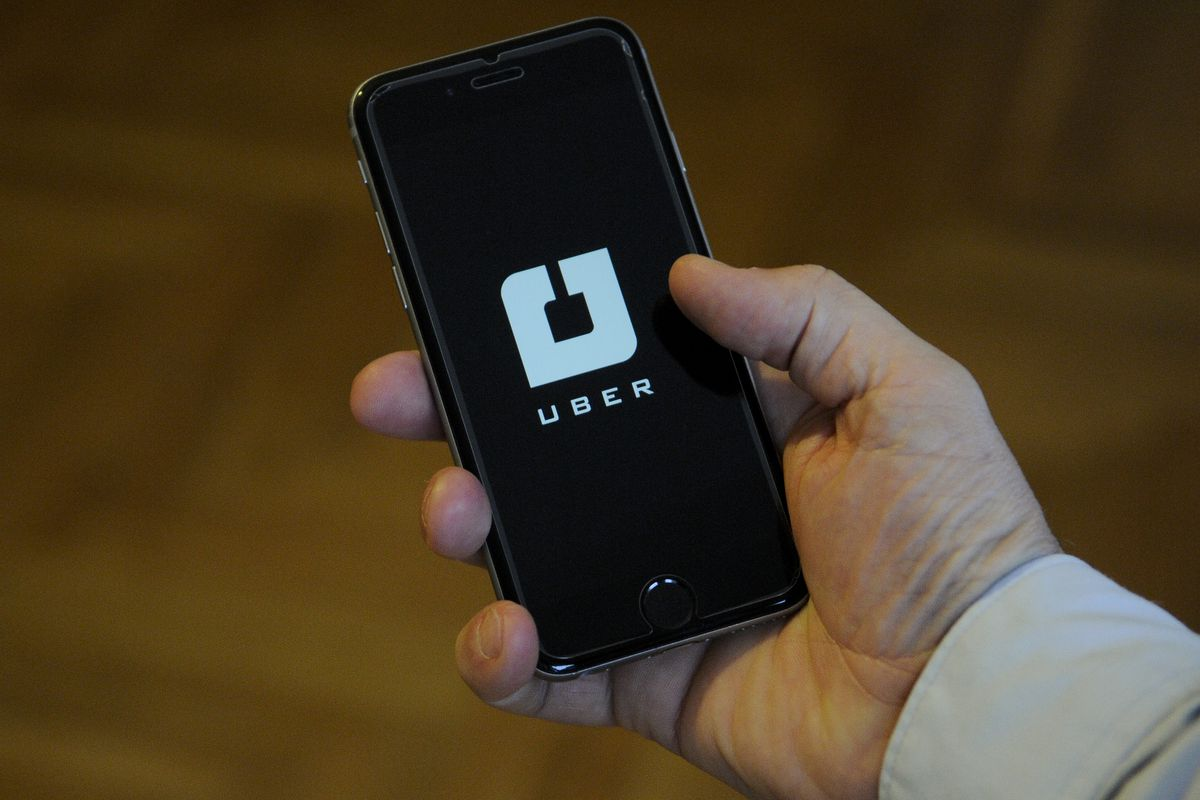 A handheld mobile phone showing the Uber app
