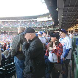 6:36 p.m. Crowded third base line aisle -