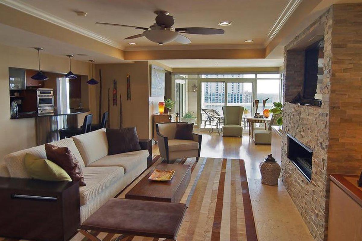 Living room with custom fireplace.