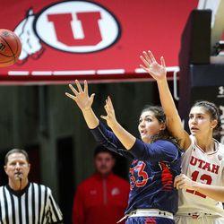 Saint Mary's center Claire Ferguson (33) awaits a pass as Utah Utes forward Emily Potter (12) applies pressure as Utah hosts Saint Mary's at the Huntsman Center in Salt Lake on Saturday, Dec. 2, 2017.